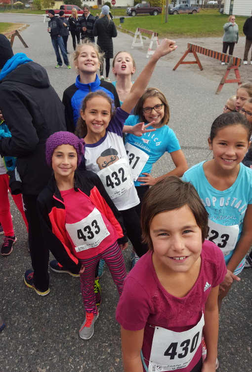 Smiles can power great things at the annual x-country run in Red Rock. Photo STMS