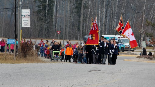 Parade led by Royal Canadian Legion Branch 242 travels towards the cenotaph. Photos OntarioNewsNorth.com 2015