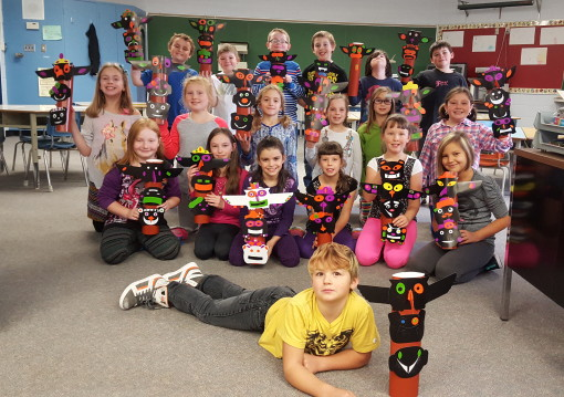 George Vanier Gr.3 and 4 students proudly pose with the Totems they created. Photo CSCNO