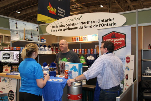 "Matt Pearson encourages booth visitors to ""Drink Superior beer"". The owner/operator of Sleeping Giant Brewing Company of Thunder Bay is among the beer, wine and spirit producers featured in the FedNor-supported Northern Ontario Agri-food Pavilion. Supplied photo."