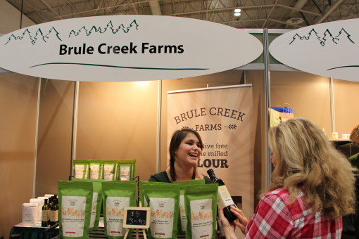 As crowds of people mill through the Enercare Centre in Toronto, Andrea Burke of Brule Creek Farms (Kakabeka Falls)  is only too happy to share details about how her stone-milled flour, cookie and dough mixes, and yellow canola oil are produced. Supplied photo.