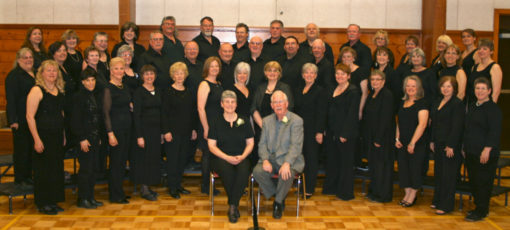 Conductor/Director Gerry Price (in grey) with the North Shore Singers.